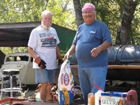 Wayne Malone on left and Al Flores BBQing at summer picnic.